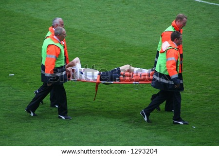 Broken Leg. Professional footballer is carried off the field. Preston v Leeds May 8th 2006.