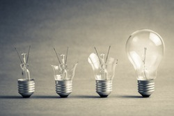 Broken light bulb step to the perfect one, failure to success, improvement idea