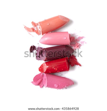 Broken lipstick make up isolated on a white background Photo stock ©