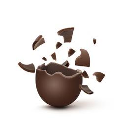 Broken milk chocolate egg on white background
