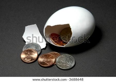 broken nestegg with US pennies and nickels