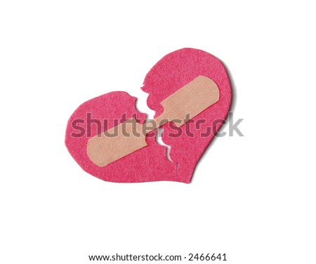 Broken paper heart held together with a bandaid