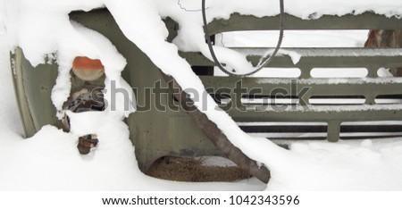 Broken part of a Soviet car #1042343596