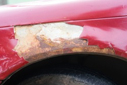 broken part of car body with rusty in old car.rust body car damage.