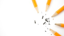 broken pencils are lying on a white background