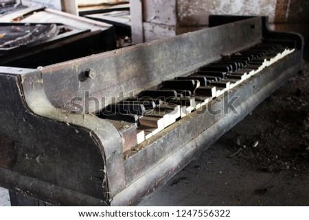 Broken piano inside of abandoned house  #1247556322