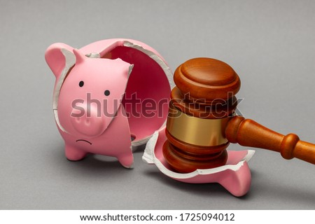 Broken piggy bank and judge gavel on gray background. Bankruptcy, crisis concept. Stock photo ©