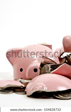 Broken piggy bank filled with loose change - stock photo