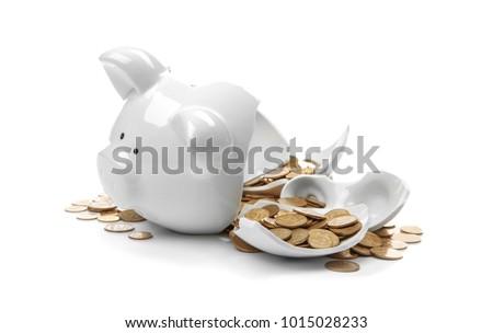 Broken piggy bank with money on white background #1015028233
