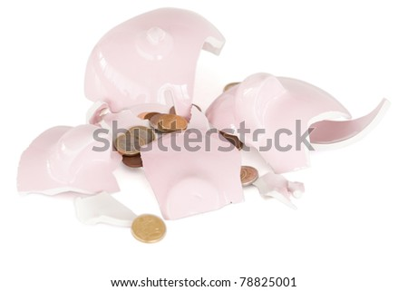 Broken piggy savings bank against a white background