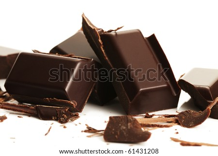 broken plain chocolate pieces on white background