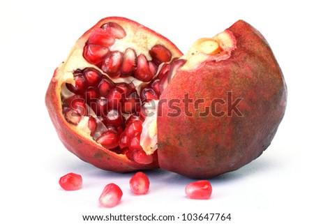 Broken pomegranate fruit on white