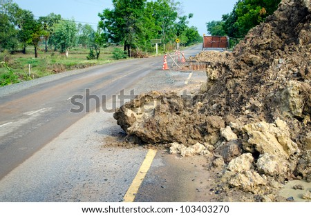Broken road by an flood or landslide (road sign), Thailand.