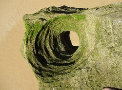 Broken rock with eroded holes of the geological phenomenon of