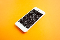 Broken screen of smartphone on the orange background. Smashed glass of cell phone, illustration for repair, fix phone services. Side