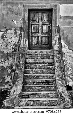 broken stairs at the entrance to the house