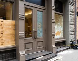 Broken store window after New York black live matters protest