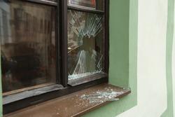 Broken street window and shards of glass