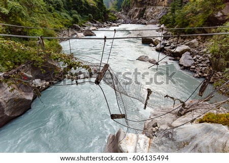 broken suspension bridge in...
