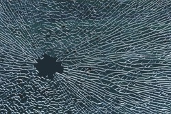 Broken tempered glass, a hole in the window glass or car windshield