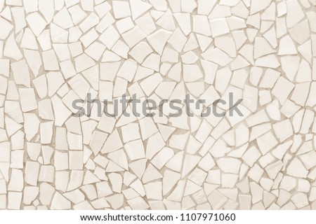 Broken tiles mosaic seamless pattern. White and cream the tile wall high resolution real photo or brick seamless and texture interior background. #1107971060