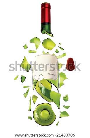 Broken to pieces. A bottle of wine made of green transparent glass with label and red top broken into pieces.