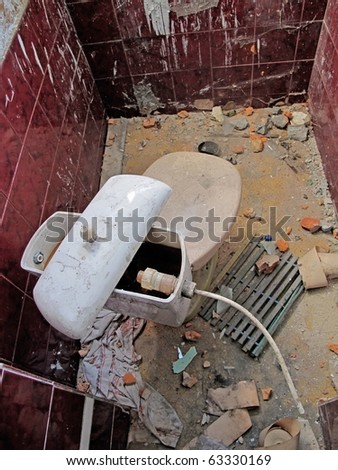Broken toilet in old abandoned house