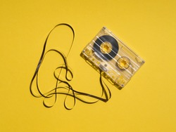 Broken transparent cassette tape reflecting light