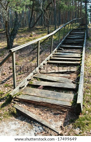 http://image.shutterstock.com/display_pic_with_logo/178834/178834,1221583811,1/stock-photo-broken-weathered-wooden-stairs-at-pine-forest-17499649.jpg