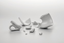 broken white cup with few little pieces, concept disintegration, mock up