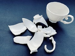 broken white porcelain cup and sturdy cup