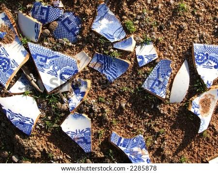Broken Willow Pattern China in an old rubbish dump in Sturt National Park, Australia