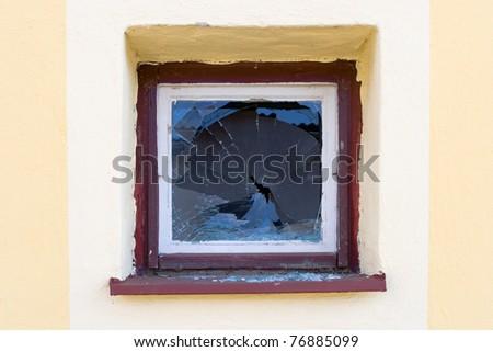 Broken window by angry vandal