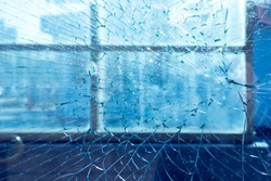 broken window in frame. on the background of the city and street. texture, background