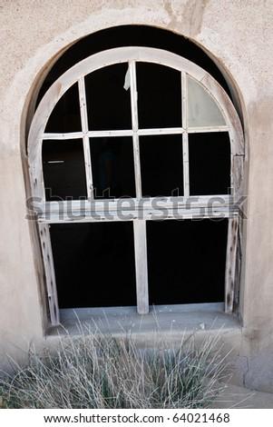 Broken window of old house in ghost town Kolmanskop, Namibia
