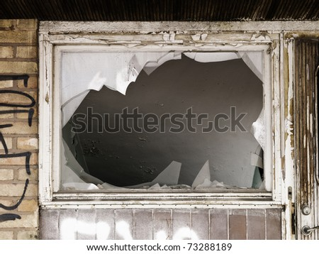 Broken window on a worn building