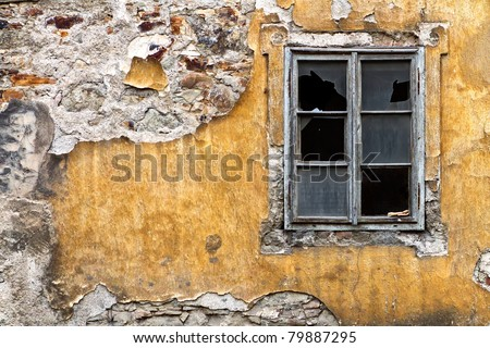 broken window on the yellow  wall