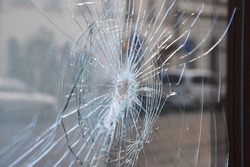Broken window shop with smashed glass