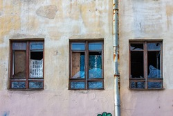 broken windows. abandoned house. collapsing building.  the wall of the old house