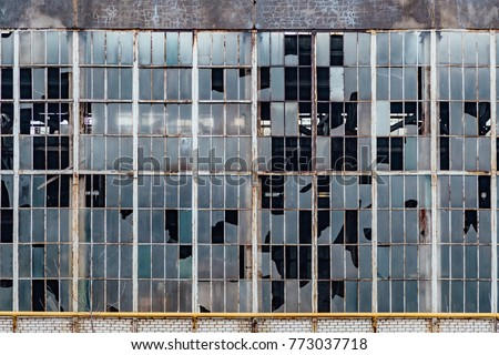 Broken windows in an old abandoned industrial building