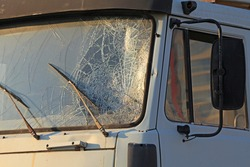 Broken windshield of a truck (lorry). Accident and traffic accident. The crash. A gunshot attack on a car. Abandoned truck after an accident