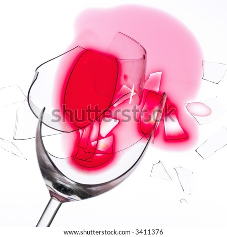 broken wine glass with red wine on a white tablecloth (macro, high key))