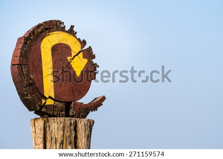 Broken wood U-Turn signpost