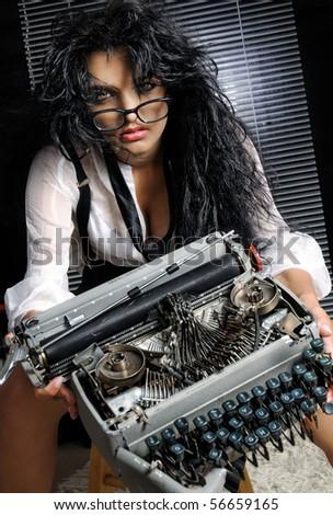 Broken Words. Model holding broken typewriter