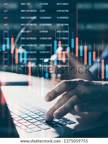 Broker using laptop and analysing the financial data at his office. Concept of a digital diagram, graph interface, virtual screen, technical price indicator, trading online, global market