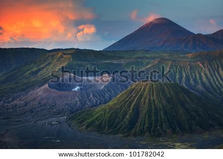 Bromo volcano (left) in Tengger Semeru National Park at sunrise. Java, Indonesia