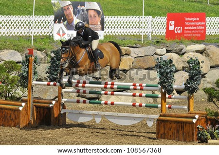 BROMONT-CANADA JULY 25: Unknown rider on a horse during 2012, INTERNATIONAL BROMONT on July 25, 2012 At the Equestrian 1976 Montreal Olympic Park.