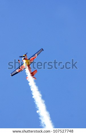 BROMONT - QUEBEC - CANADA JULY 1: Pete McLeod in action at the LEUCAN Air show a for cancer research on July 01, 2012 Bromont Canada. Pete is a Canadian professional aerobatic pilot .