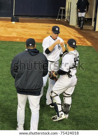 BRONX, NY - APRIL 13: AJ Burnett and Russell Martin of the New York Yankees congratulate each other after a bullpen session before a game against the Baltimore Orioles on April 13, 2011 in Bronx, NY