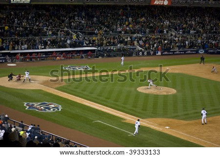 BRONX, NY - OCTOBER 17: Johnny Damon at bat, Derek Jeter at first during game 2 of the ALSC at Yankee Stadium on October 17, 2009 in the Bronx. - stock photo